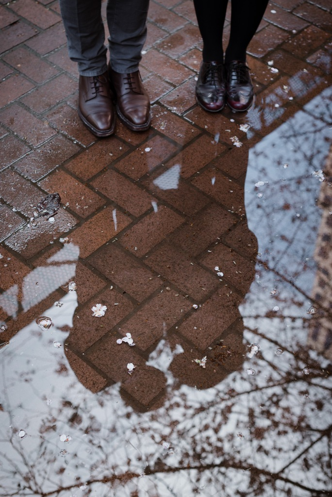 vancouver bc, engagement photographer, rain, puddle, reflection, cherry blossom, waterfront station