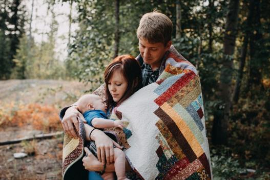 family, newborn, baby, photography, forest, blanket, hug, lifestyle